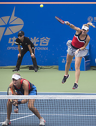 WUHAN, Sept. 27, 2018  Timea Babos (R) of Hungary and Kristina Mladenovic of France compete during doubles quarterfinal match against Shuko Aoyama of Japan and Lidziya Marozava of Russia at the 2018 WTA Wuhan Open tennis tournament in Wuhan of central China's Hubei Province, on Sept. 27, 2018. Shuko Aoyama and Lidziya Marozava won 2-0. (Credit Image: © Xiao Yijiu/Xinhua via ZUMA Wire)