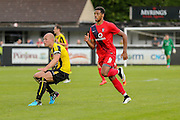 Danny Ellis and Vadaine Oliver during the Friendly match between Harrogate Town and York City at Wetherby Road, Harrogate, United Kingdom on 25 July 2015. Photo by Simon Davies.