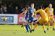 Barry Fuller (Captain) of AFC Wimbledon gets a knock from Craig Westcarr of Mansfield Town during the Sky Bet League 2 match between AFC Wimbledon and Mansfield Town at the Cherry Red Records Stadium, Kingston, England on 16 January 2016. Photo by Stuart Butcher.
