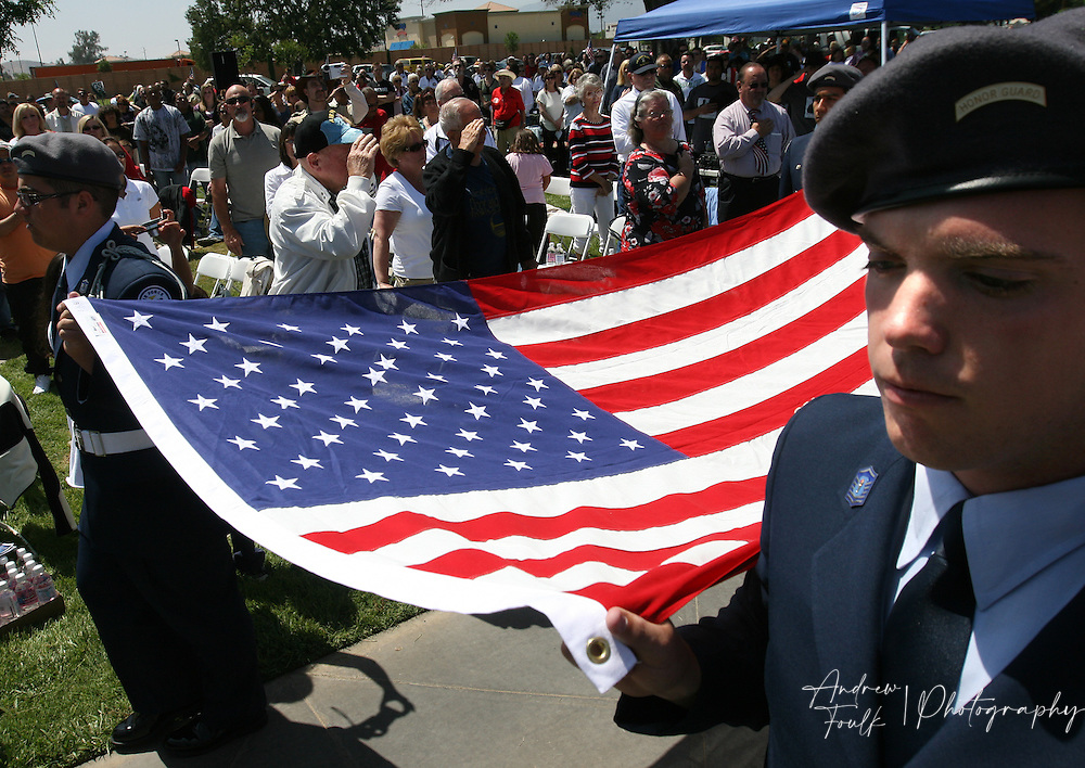/Andrew Foulk/ For the Californian/.Cadet Master Sgt. with Lake Elsinore High J.R.O.T.C. Brandon Davis, 17, helps bring out the flag for the folding ceremony, during the Lake Elsinore cemetery Memorial Day ceremony.