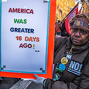 "Anti Trump  with demonstrators in Greenwich by the Stonewall Inn, holding humorous political sign against Trump, ""America Was Greater 16 Days Ago! .."""
