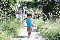 Boy (5-6 years) running on path