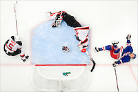 "New York Rangers forward Ryan Callahan collides with New Jersey Devils goalie Martin Brodeur in the 2008 NHL Stanley Cup playoffs. This photo appeared as a two-page spread in Sports Illustrated's ""Leading Off"" section."