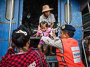 26 OCTOBER 2016 - MAE SOT, TAK, THAILAND:  Thai defense volunteers help Burmese children off the bus that brought them to the border in Mae Sot for their repatriation from the Nupo Temporary Shelter refugee camp. Sixtyfive Burmese refugees living in the Nupo Temporary Shelter refugee camp in Tak Province of Thailand were voluntarily repatriated to Myanmar. About 11,000 people live in the camp. The repatriation was the first large scale repatriation of Myanmar refugees living in Thailand. Government officials on both sides of the Thai / Myanmar border said the repatriation was made possible by recent democratic reforms in Myanmar. There are approximately 150,000 Burmese refugees living in camps along the Thai / Myanmar border. The Thai government has expressed interest several times in the last two years in starting the process of repatriating the refugees.     PHOTO BY JACK KURTZ