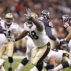 2008 August 16: New Orleans Saints defensive tackle Sedrick Ellis (98) pressures the quarterback during the first quarter of the Saints preseason match up against the Houston Texans at the Louisiana Superdome in New Orleans, LA. .