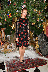 OLGA KURYLENKO at a party to celebrate the unveiling of the 2014 Claridge's Christmas tree by Dolce & Gabbana at Claridge's, Brook Street, London on 19th November 2014.