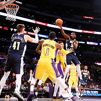 02 October 2017: Denver Nuggets forward Kenneth Faried (35) passes the ball to Denver Nuggets forward Juan Hernangomez (41) over Los Angeles Lakers forward Kyle Kuzma (0) and Los Angeles Lakers guard Kentavious Caldwell-Pope (1) during the Denver Nuggets 113-107 victory over the LA Lakers, at the Staples Center, Los Angeles, California, USA.