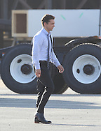 July 1st 2010 Los Angeles, CA. ***EXCLUSIVE*** Shia LaBeouf and Rosie Huntington-Whiteley walk to the set of Transformers 3 to film a scene together. Rosie is wearing a funny kitchen apron with pictures of rose flowers and President Obama. Photo by Eric Ford 818-613-3955 info@onlocationnews.com
