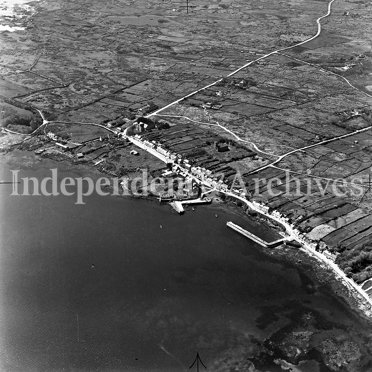 A355 Roundstone.    (Part of the Independent Newspapers Ireland/NLI collection.)<br /> <br /> <br /> These aerial views of Ireland from the Morgan Collection were taken during the mid-1950's, comprising medium and low altitude black-and-white birds-eye views of places and events, many of which were commissioned by clients. From 1951 to 1958 a different aerial picture was published each Friday in the Irish Independent in a series called, 'Views from the Air'.The photographer was Alexander 'Monkey' Campbell Morgan (1919-1958). Born in London and part of the Royal Artillery Air Corps, on leaving the army he started Aerophotos in Ireland. He was killed when, on business, his plane crashed flying from Shannon.