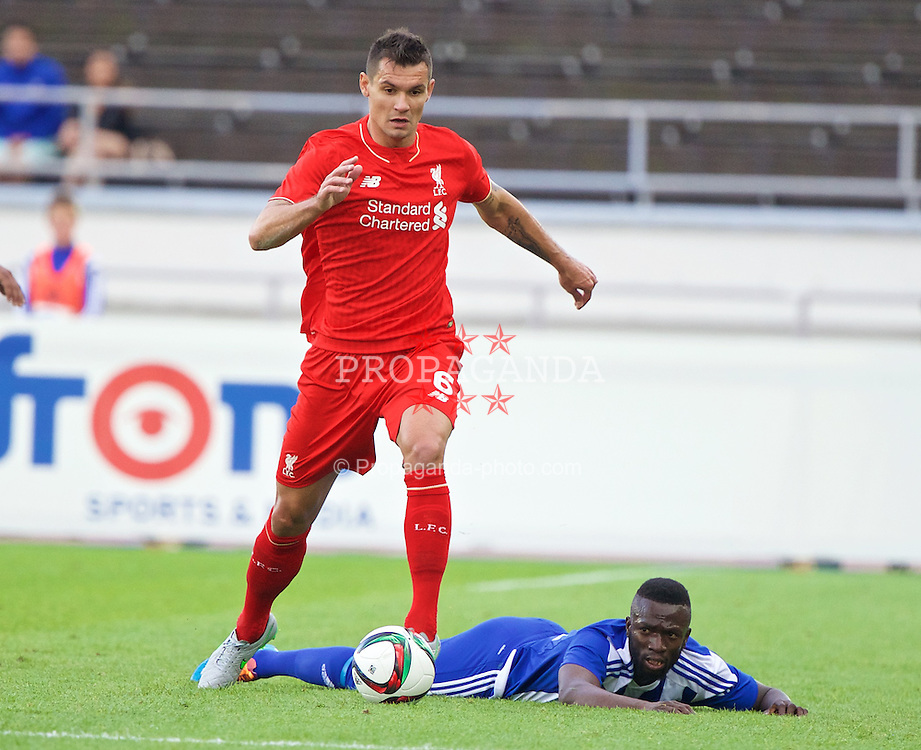 HELSINKI, FINLAND - Friday, July 31, 2015: Liverpool's Dejan Lovren in action against HJK Helsinki's Formose Mendy during a friendly match at the Olympic Stadium. (Pic by David Rawcliffe/Propaganda)