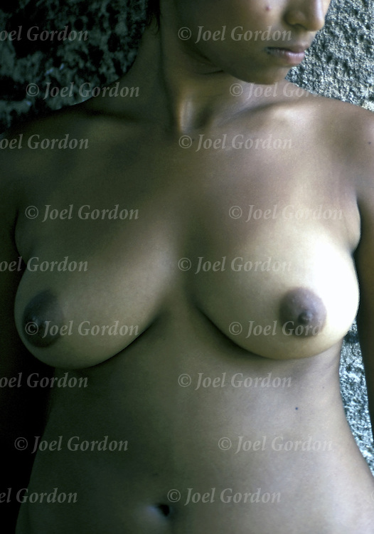 Young East Indian woman. Female breast shape, size and appearance vary greatly.