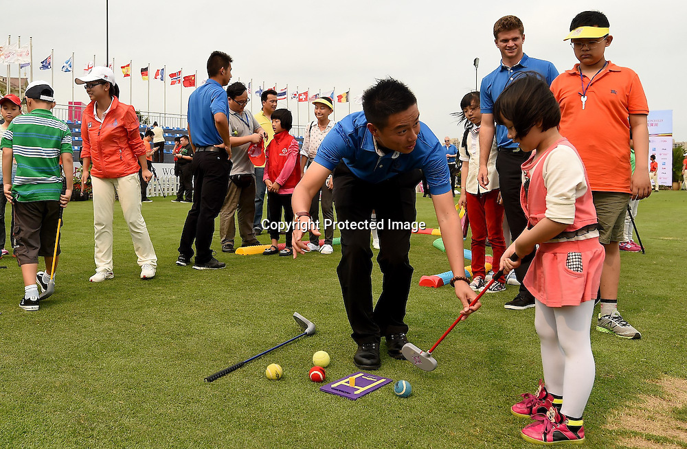 HAIKOU- HAINAN ISLAND-CHINA- Golf Clinics for Kids on Saturday, March 14, 2015, of the World Ladies Championship at the Blackstone Course, Mission Hills Golf Resort Haikou, Hainan Island, China. The USD$ 600.000 event is staged March 12-15, 2015. Picture by Khalid Redza/Mission Hills.