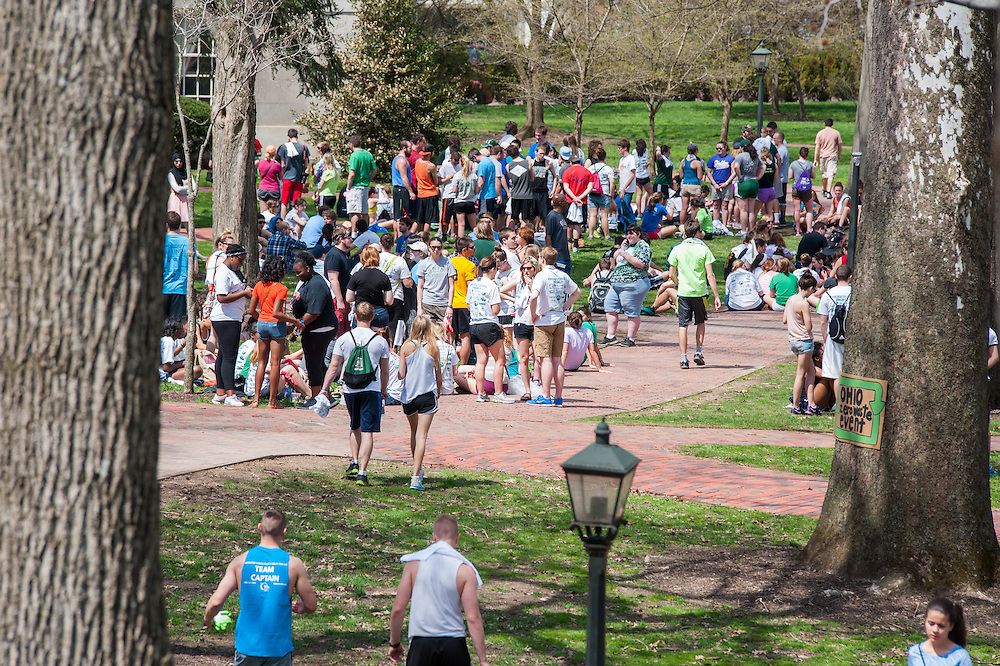 Students and Athens community gather on Ohio University College Green before dispersing to clean up litter throughout the city. Photo by Elizabeth Held