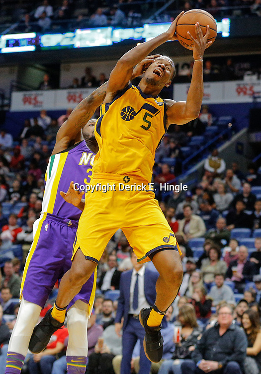 Feb 5, 2018; New Orleans, LA, USA; Utah Jazz guard Rodney Hood (5) is fouled by New Orleans Pelicans guard DeAndre Liggins (34) during the second half at the Smoothie King Center. The Jazz defeated the Pelicans 133-109. Mandatory Credit: Derick E. Hingle-USA TODAY Sports
