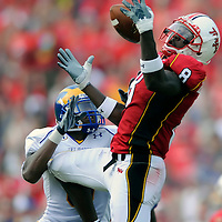 30 August 2008:  Maryland wide receiver Darrius Heyward-Bey (8) catches a 36 yard pass against Delaware defensive back Anthony Walters (9) in the 1st half on August 30, 2008 in a game at Byrd Stadium in College Park, MD.  The Terrapins defeated the Blue Hens 14-7.