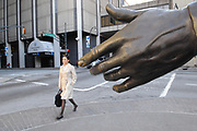 Former Atlanta mayor Andrew Young's hand reaches out towards an unsuspecting pedestrian