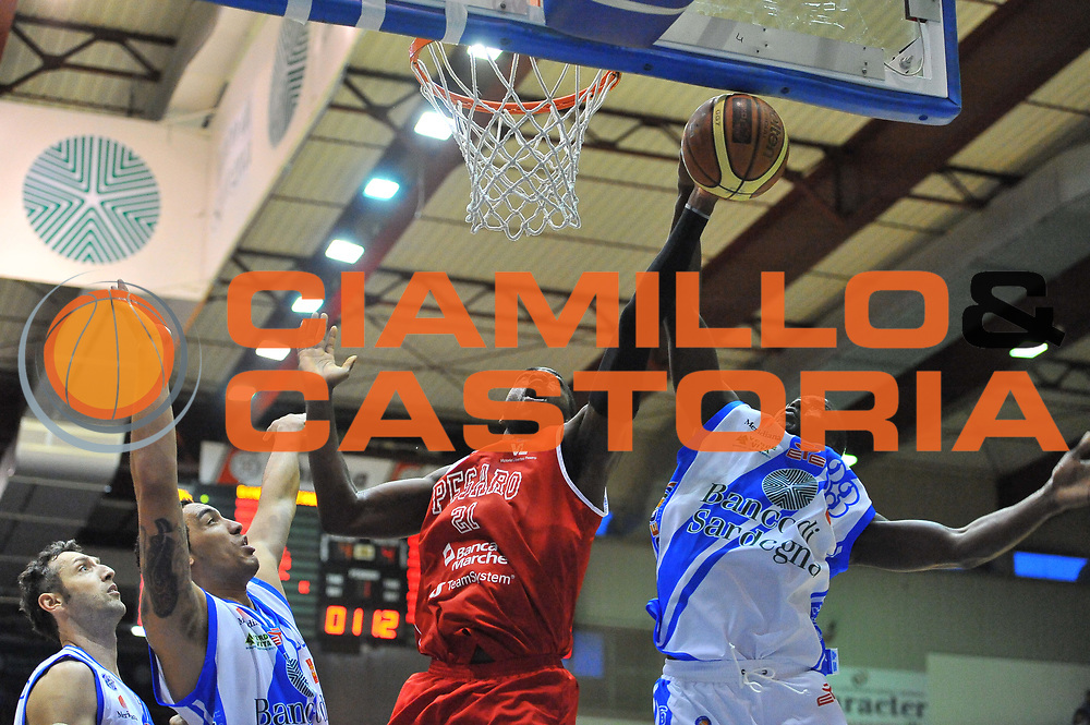 DESCRIZIONE : Campionato 2013/14 Dinamo Banco di Sardegna Sassari - Victoria Libertas Pesaro<br /> GIOCATORE : Oberah Anosike Omar Thomas<br /> CATEGORIA : Stoppata<br /> SQUADRA : Victoria Libertas Pesaro<br /> EVENTO : LegaBasket Serie A Beko 2013/2014<br /> GARA : Dinamo Banco di Sardegna Sassari - Victoria Libertas Pesaro<br /> DATA : 02/03/2014<br /> SPORT : Pallacanestro <br /> AUTORE : Agenzia Ciamillo-Castoria / Luigi Canu<br /> Galleria : LegaBasket Serie A Beko 2013/2014<br /> Fotonotizia : Campionato 2013/14 Dinamo Banco di Sardegna Sassari - Victoria Libertas Pesaro<br /> Predefinita :