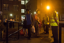 London, June 23rd 2017. Residents of Chalcot Estate, a complex of five tower blocks, are evacuated over concerns that the cladding used in a refurbishment is the same as that used in the Grenfell Tower Fire disaster that's so far claimed 79 lives.The cladding from all five towers will be removed over the next few weeks. PICTURED: People leave Taplow Tower with just a few possessions packed into suitcases and plastic bags.