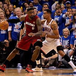 Jun 12, 2012; Oklahoma City, OK, USA; Miami Heat small forward LeBron James (6) is guarded by Oklahoma City Thunder shooting guard Thabo Sefolosha (2) during the fourth quarter of game one in the 2012 NBA Finals at the Chesapeake Energy Arena. Mandatory Credit: Derick E. Hingle-US PRESSWIRE