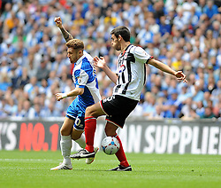 Bristol Rovers' Matty Taylor is challenged by Grimsby's Shaun Pearson - Photo mandatory by-line: Neil Brookman/JMP - Mobile: 07966 386802 - 17/05/2015 - SPORT - football - London - Wembley Stadium - Bristol Rovers v Grimsby Town - Vanarama Conference Football