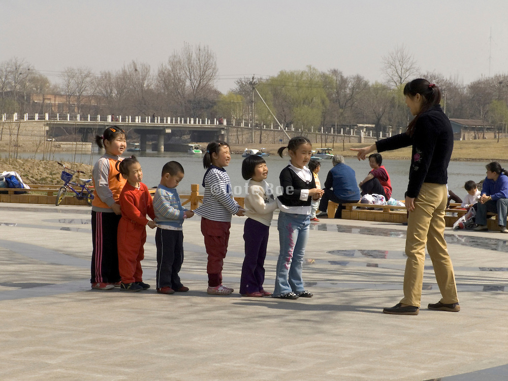 children learning a dance Chaoyang park Beijing China