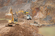 Machines at work in the Pemali mine, the biggest legal mine in Bangka has completely devastated the once green landscape. Operated by PT-Timah. It produces 60 tons of tin per month. Indonesia is the worlds biggest tin provider, vital for assembling smart phones and other electronic products.  Bangka Island (Indonesia) is devastated by tin mines. The demand for tin has increased due to its use in smart phones and tablets.<br /> <br /> Machines à l'oeuvre dans la Mine de Pemali, la plus grande mine légale de Bangka, qui a complètement dévasté un paysage qui était autrefois verte. Exploité par PT-Timah, elle produit 60 tonnes d'étain par mois. L'Indonésie est le plus grand fournisseur mondes d'étain, vital pour l'assemblage des téléphones et autres produits électroniques. L'île de Bangka (Indonésie) est dévastée par des mines d'étain. La demande de l'étain a explosé à cause de son utilisation dans les smartphones et tablettes.