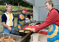"""Master """"flipper"""" Mike Warminton along with Rick Andrews, Kurt Webber and Forrest Aldridge cook pancakes for hundreds that turned out for the annual Gilford Rotary Pancake Breakfast prior to the Gilford Old Home Day parade on Saturday morning at the Gilford Community Church.  (Karen Bobotas/for the Laconia Daily Sun)"""