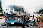 BANGALORE,2000.<br /> A bus set on fire on Bellary Road in Bangalore,India in the wake of protests against the kidnapping of the Kannada mega star, Dr Rajkumar, by the forest brigand, Veerappan and his gang at Gajanur in Tamil Nadu on the Karnataka-Tamil Nadu border.