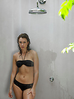 Young Woman in Bikini Showering
