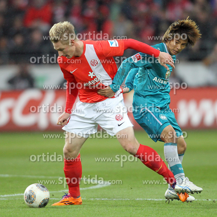 10.11.2013, Coface Arena, Mainz, GER, 1. FBL, 1. FSV Mainz 05 vs Eintracht Frankfurt, 12. Runde, im Bild links: Polter Sebastian (9) / FSV Mainz 05, rechts: Inui, Takashi (8) / Eintracht-Frankfurt // during the German Bundesliga 12th round match between 1. FSV Mainz 05 and Eintracht Frankfurt at the Coface Arena in Mainz, Germany on 2013/11/10. EXPA Pictures &copy; 2013, PhotoCredit: EXPA/ Eibner-Pressefoto/ Kellner<br /> <br /> *****ATTENTION - OUT of GER*****