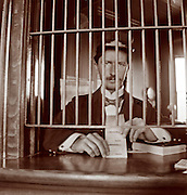 Vintage Photo: Railroad Ticket agent in his booth at train station circa 1900. transportation.