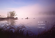 "Early morning sun coloring the fog over a quiet river, with bible quote: ""Be still and know I am God."""