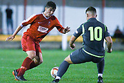 Will Ramsay of Selby Town (4) looks to take on his marker during the The FA Cup Preliminary Round match between Selby Town and Kendal Town at the Fairfax Plant Hire Stadium, Selby, United Kingdom on 4 September 2018.