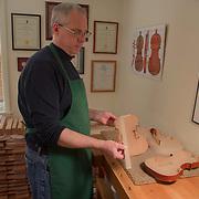 Boston violin maker Christopher White shows the parts of the violin body.
