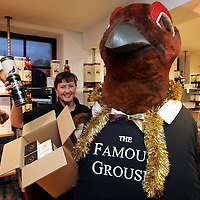 Vicky Robinson of the mail order department at The Famous Grouse Experience gets a helping hand from Gilbet the Grouse to deal with the massive demand of products that are being ordered from the Famous Grouse Experience catalogue.<br />
