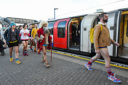 "© Licensed to London News Pictures. 12/01/2020. LONDON, UK.  Participants take part in ""No Trousers On The Tube Day"".  Now in its 11th year, the annual event sees hundreds of riders travel on the tube without wearing trousers.  Similar rides are taking place worldwide under the umbrella of ""No Pants Subway Ride"", which launched in New York in 2002.  Photo credit: Stephen Chung/LNP"