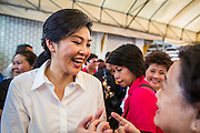 17 FEBRUARY 2013 - BANGKOK, THAILAND:  Thai Prime Minister YINGLUCK SHINAWATRA campaigns for Pongsapat Pongchareon in Wat Chana Songkram in Bangkok Sunday. Pol General Pongsapat Pongcharoen, a former deputy national police chief who also served as secretary-general of the Narcotics Control Board is the Pheu Thai Party candidate in the upcoming Bangkok governor's election. Yingluck is the head of the Pheu Thai party and campaigns with Pongsapat. (He resigned from the police force to run for Governor.) Former Prime Minister Thaksin Shinawatra reportedly recruited Pongsapat. Most of Thailand's reputable polls have reported that Pongsapat is leading in the race and likely to defeat Sukhumbhand Paribatra, the Thai Democrats' candidate and incumbent. The loss of Bangkok would be a serious blow to the Democrats, whose base is the Bangkok area.     PHOTO BY JACK KURTZ