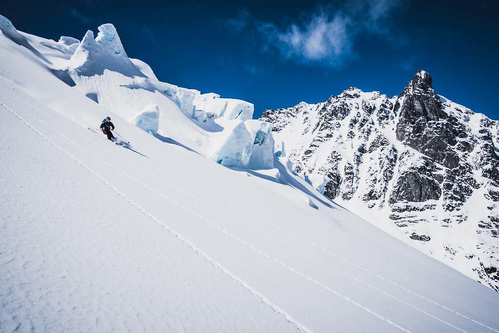 Emily Bodner and Loft Peak Glacier with Hut Peak in the background, Howson Range, British Columbia.