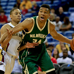 Nov 1, 2016; New Orleans, LA, USA; Milwaukee Bucks forward Giannis Antetokounmpo (34) is defended by New Orleans Pelicans guard Tim Frazier (2) during the first quarter of a game at the Smoothie King Center. Mandatory Credit: Derick E. Hingle-USA TODAY Sports