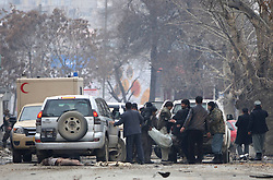Afghan security officers carry a victim of a blast onto an ambulance in Kabul, Afghanistan, on Jan. 16, 2013. A powerful blast rocked Afghan capital Kabul on Wednesday leaving over a dozen dead and injured, an eye witness said,  January 16, 2013. Photo by Imago / i-Images...UK ONLY