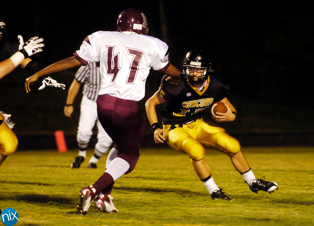 Concord's Sean Willix looks for room to run against Jay M. Robinson Friday, September 5, 2008. Concord won the game 16-14. (photo by James Nix)