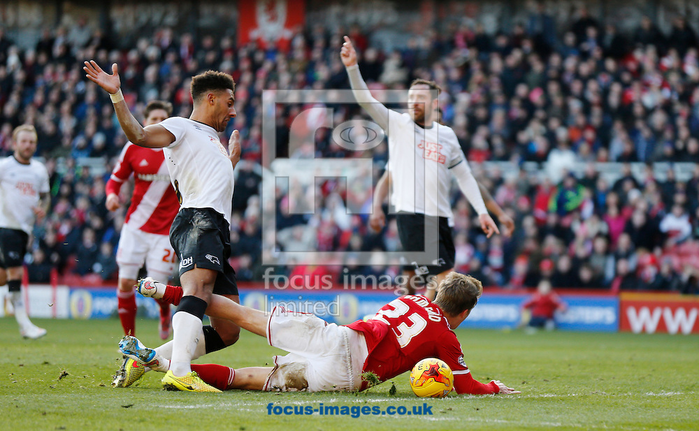 Patrick Bamford (r) of Middlesbrough getting fouled in the box by Ryan Shotton of Derby County during the Sky Bet Championship match at the Riverside Stadium, Middlesbrough<br /> Picture by Simon Moore/Focus Images Ltd 07807 671782<br /> 13/12/2014