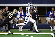 Dallas Cowboys rookie wide receiver Michael Gallup (13) catches a 40 yard deep pass down the sideline for a first down at the New Orleans Saints 6 yard line while covered by New Orleans Saints cornerback Eli Apple (25) in the first quarter during the NFL week 13 regular season football game against the New Orleans Saints on Thursday, Nov. 29, 2018 in Arlington, Tex. The Cowboys won the game 13-10. (©Paul Anthony Spinelli)