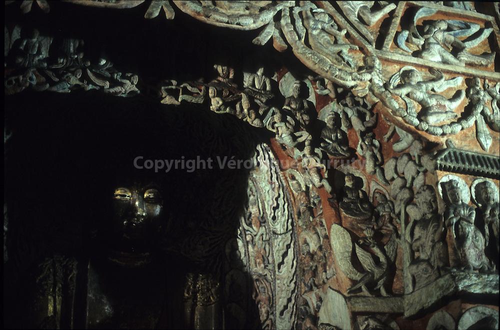 Le Bouddha dans l'ombre, Grottes de Yungang, Region de Datong, Shanxi, Chine