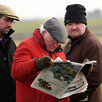 Racing punters checking the form as they wait for the 1st race at the Clare Hunt point to point in Bellharbour on Sunday.<br /> Photograph by Yvonne Vaughan