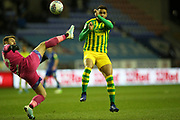 Wigan Athletic goalkeeper Jamie Jones (23) and West Bromwich Albion forward Hal Robson-Kanu (4) during the EFL Sky Bet Championship match between Wigan Athletic and West Bromwich Albion at the DW Stadium, Wigan, England on 11 December 2019.