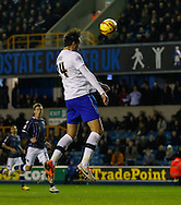 Picture by David Horn/Focus Images Ltd +44 7545 970036<br /> 28/01/2014<br /> Atdhe Nuhiu of Sheffield Wednesday puts a clear header over the bar during the Sky Bet Championship match at The Den, London.