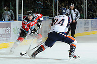 KELOWNA, CANADA, OCTOBER 29: Shane McColgan #18 of the Kelowna Rockets skates with the puck while being checked by Josh Caron #24 of the Kamloops Blazers as the Kamloops Blazers visit the Kelowna Rockets  on October 29, 2011 at Prospera Place in Kelowna, British Columbia, Canada (Photo by Marissa Baecker/Shoot the Breeze) *** Local Caption *** Shane McColgan; Josh Caron;