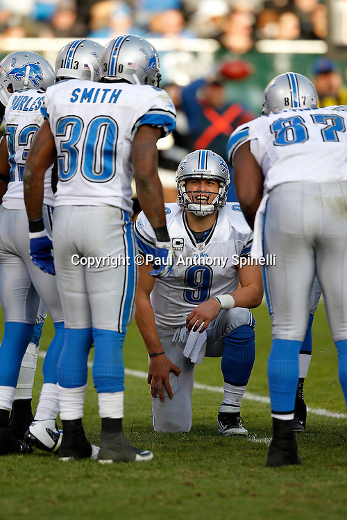 Detroit Lions quarterback Matthew Stafford (9) calls a play in the offensive huddle during the NFL week 15 football game against the Oakland Raiders on Sunday, December 18, 2011 in Oakland, California. The Lions won the game 28-27. ©Paul Anthony Spinelli