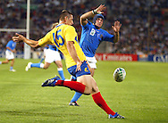 Marseille, FRANCE - 12th September 2007, Lulian Dumitras of Romania clears the ball from his line during the Rugby World Cup, pool C, match between Italy and Romania held at the Stade Velodrome in Marseille, France...Photo: Ron Gaunt/ Sportzpics